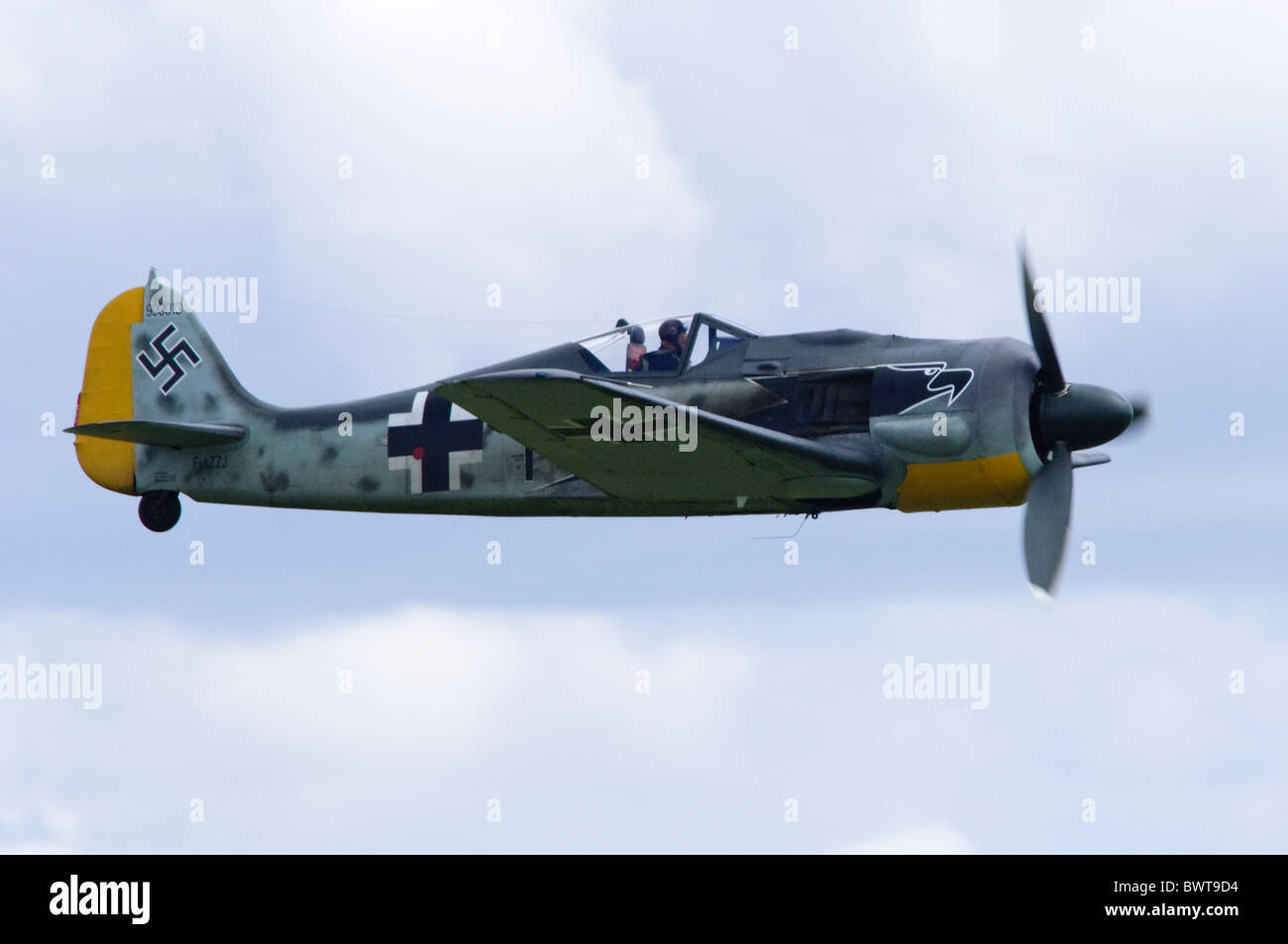 Flugwerk-built Focke Wulf FW 190 A8/N in Luftwaffe colours making a flypast at Duxford Flying Legends Airshow - Stock Image