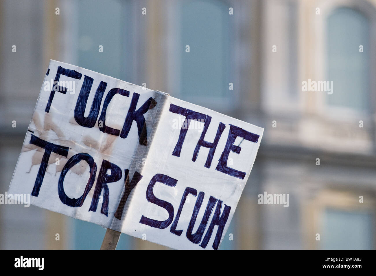 A placard protesting against the Conservative party. - Stock Image