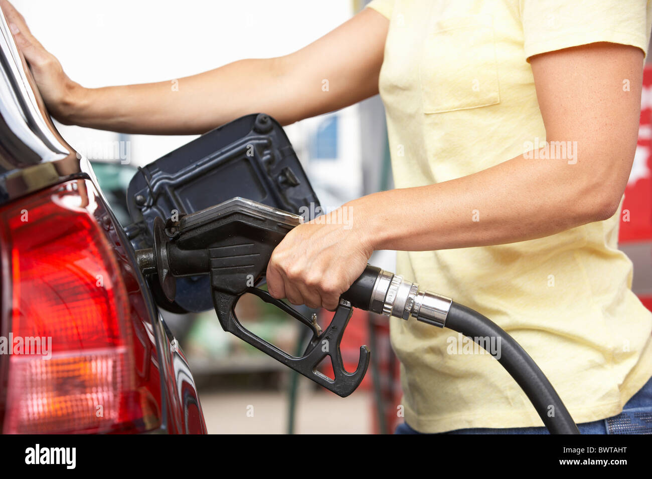 Detail Of Female Motorist Filling Car With Diesel At Petrol Station - Stock Image