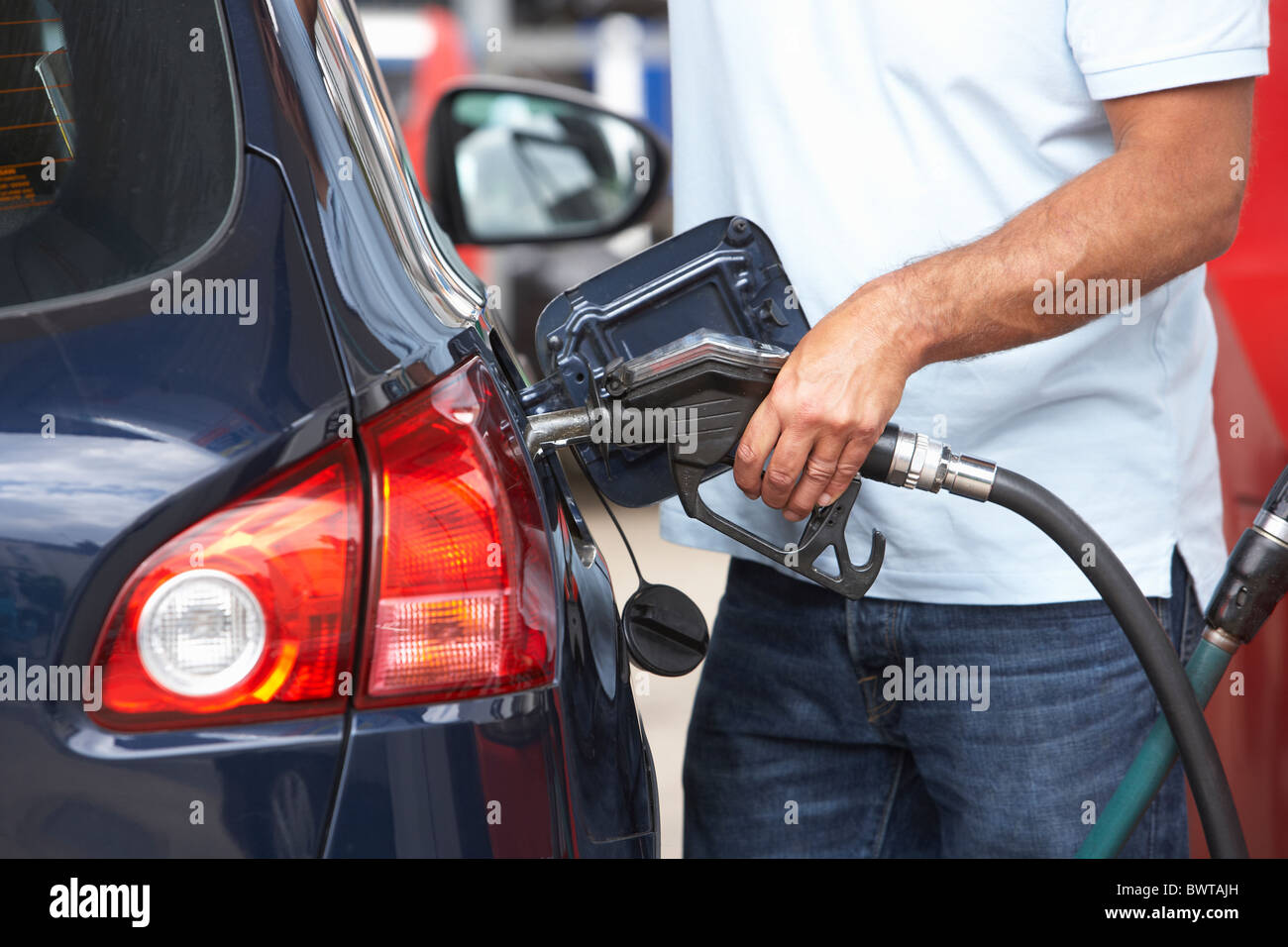 Detail Of Male Motorist Filling Car With Diesel At Petrol Station - Stock Image