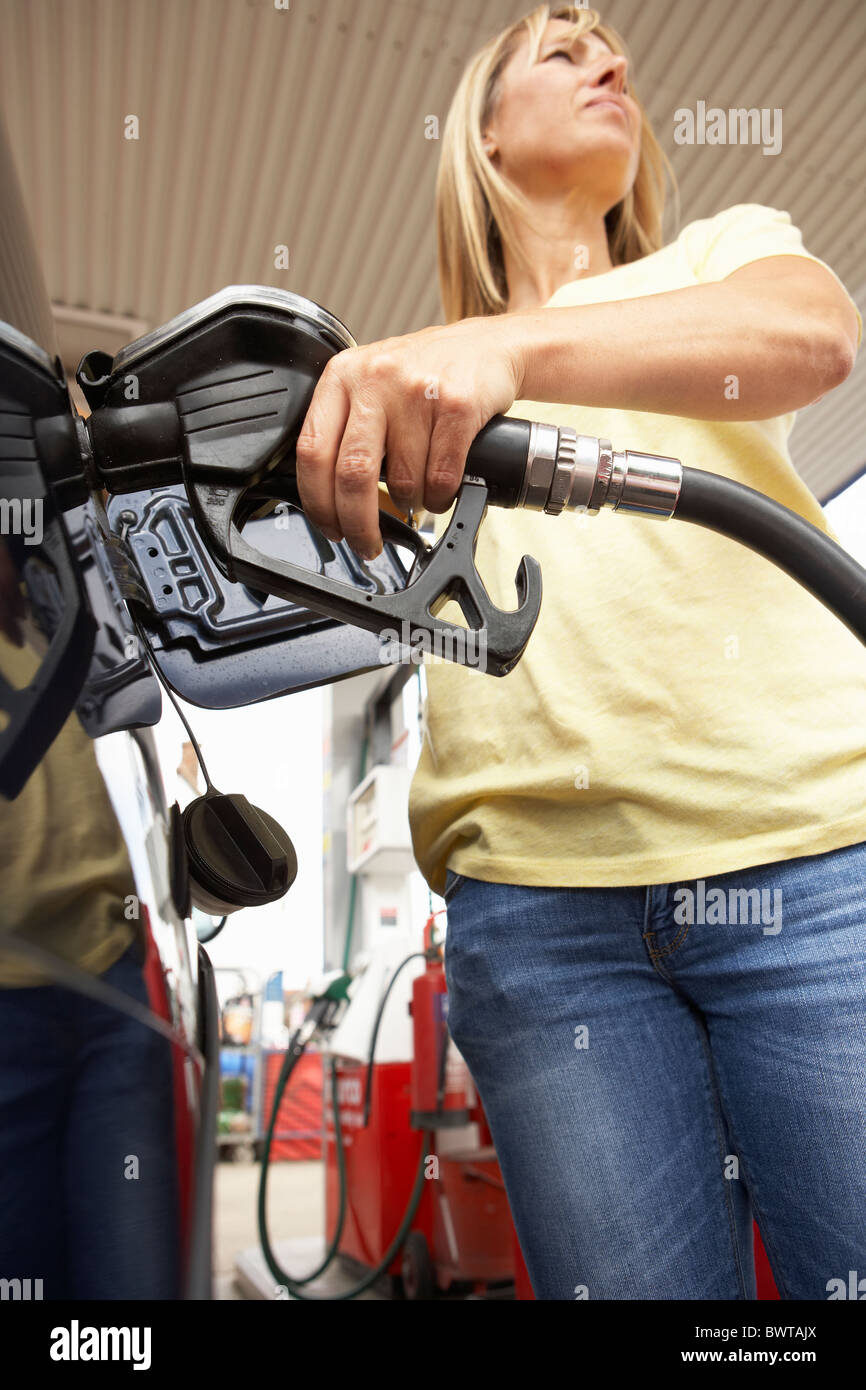 Female Motorist Filling Car With Diesel At Petrol Station - Stock Image