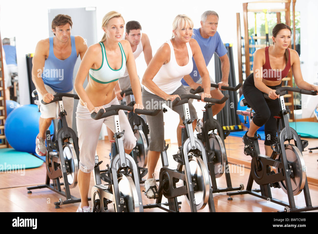 Group, People In Spinning Class In Gym - Stock Image