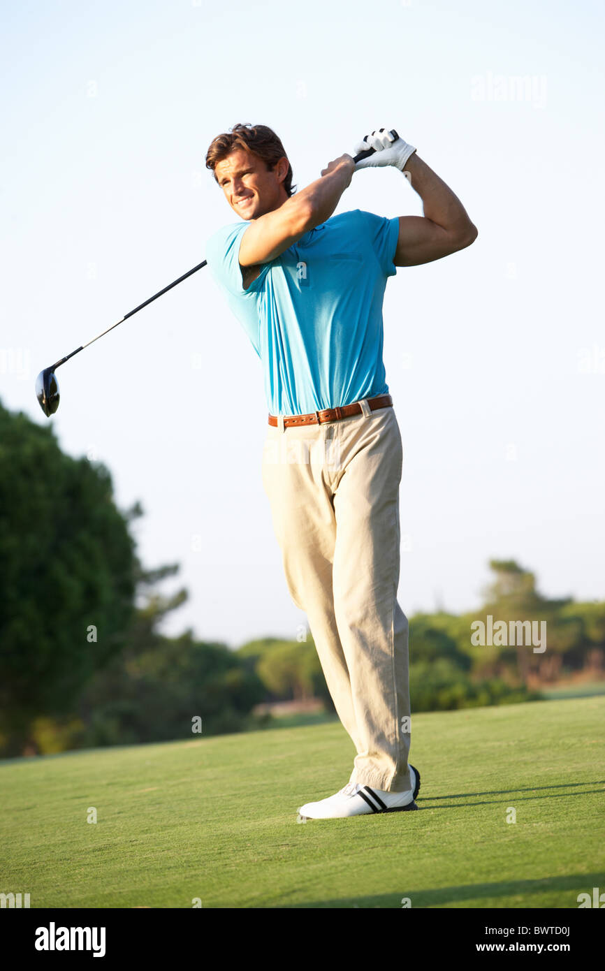 Male Golfer Teeing,f On Golf Course - Stock Image