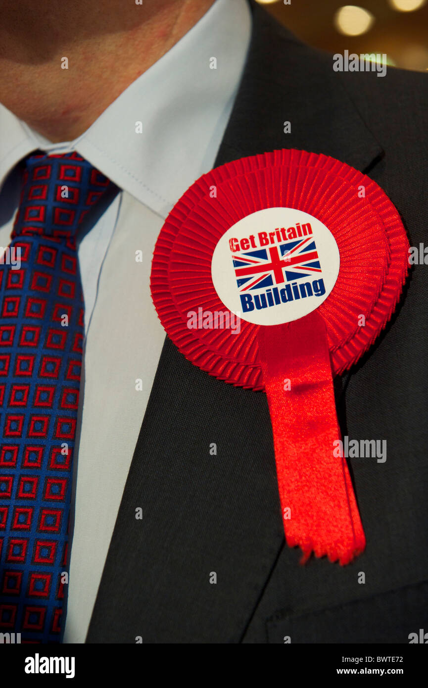 A delegate socializes in the main auditorium after a speech during the second day of the Conservatives Party Conference - Stock Image