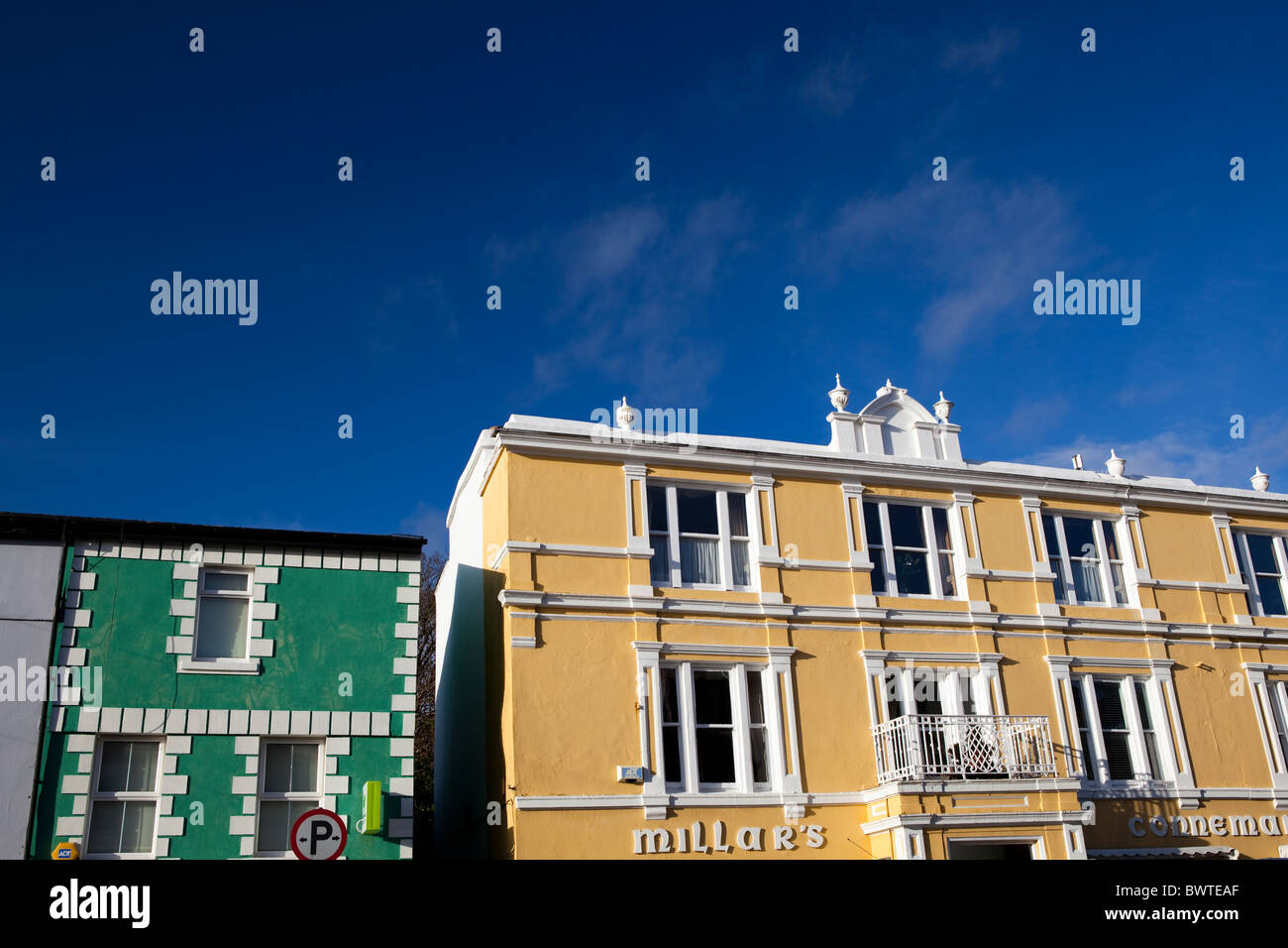 Typical 19th century shopfronts in Clifden, Co Galway, Connemara, Ireland - Stock Image