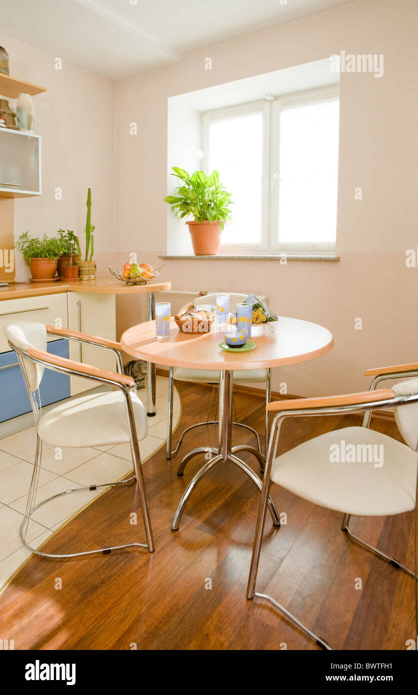 Photo of round table and two chairs near by in the kitchen Stock Photo