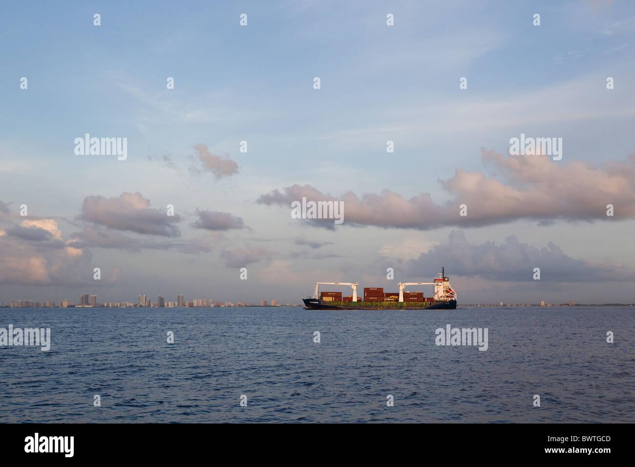 Cargo ship at sea near city, Daytona, Florida - Stock Image