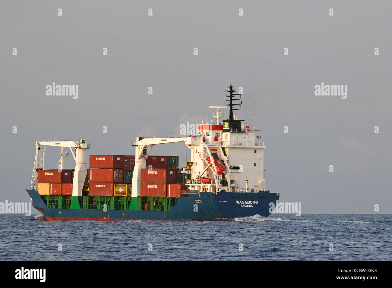 Cargo ship at sea, Atlantic Ocean, with shipping containers - Stock Image