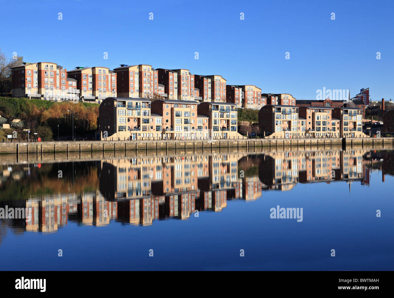 Residential properties reflected in the River Tyne, Newcastle, England, UK Stock Photo
