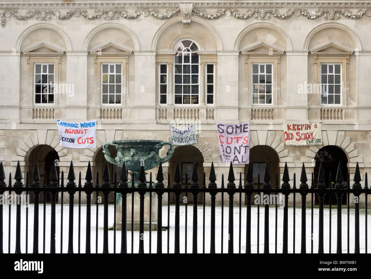 Student protest banners hanging from the Old Schools Building in Cambridge - Stock Image