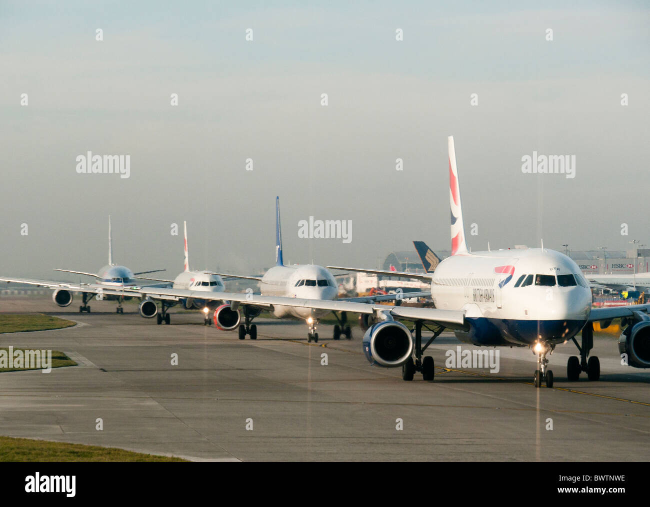 Planes queuing for takeoff at Heathrow airport in Britain - Stock Image