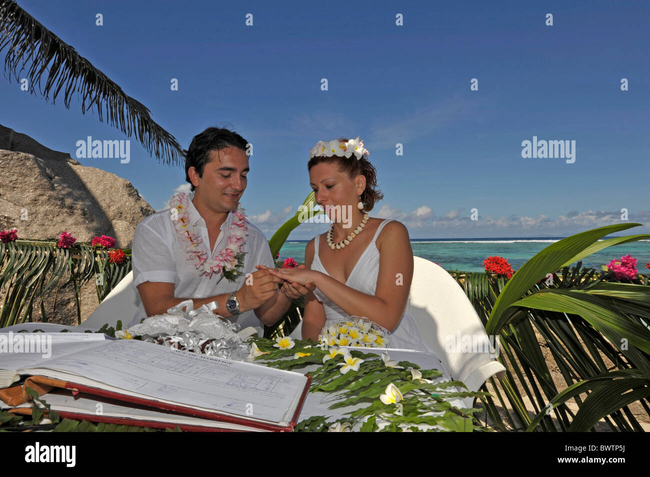 Newlyweds at marriage ceremony in La Digue, Seychelles Stock Photo