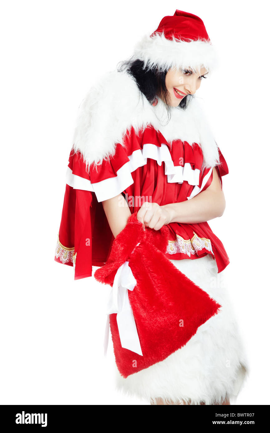 Smiling lady in the red furry costume holding bag with Christmas ...