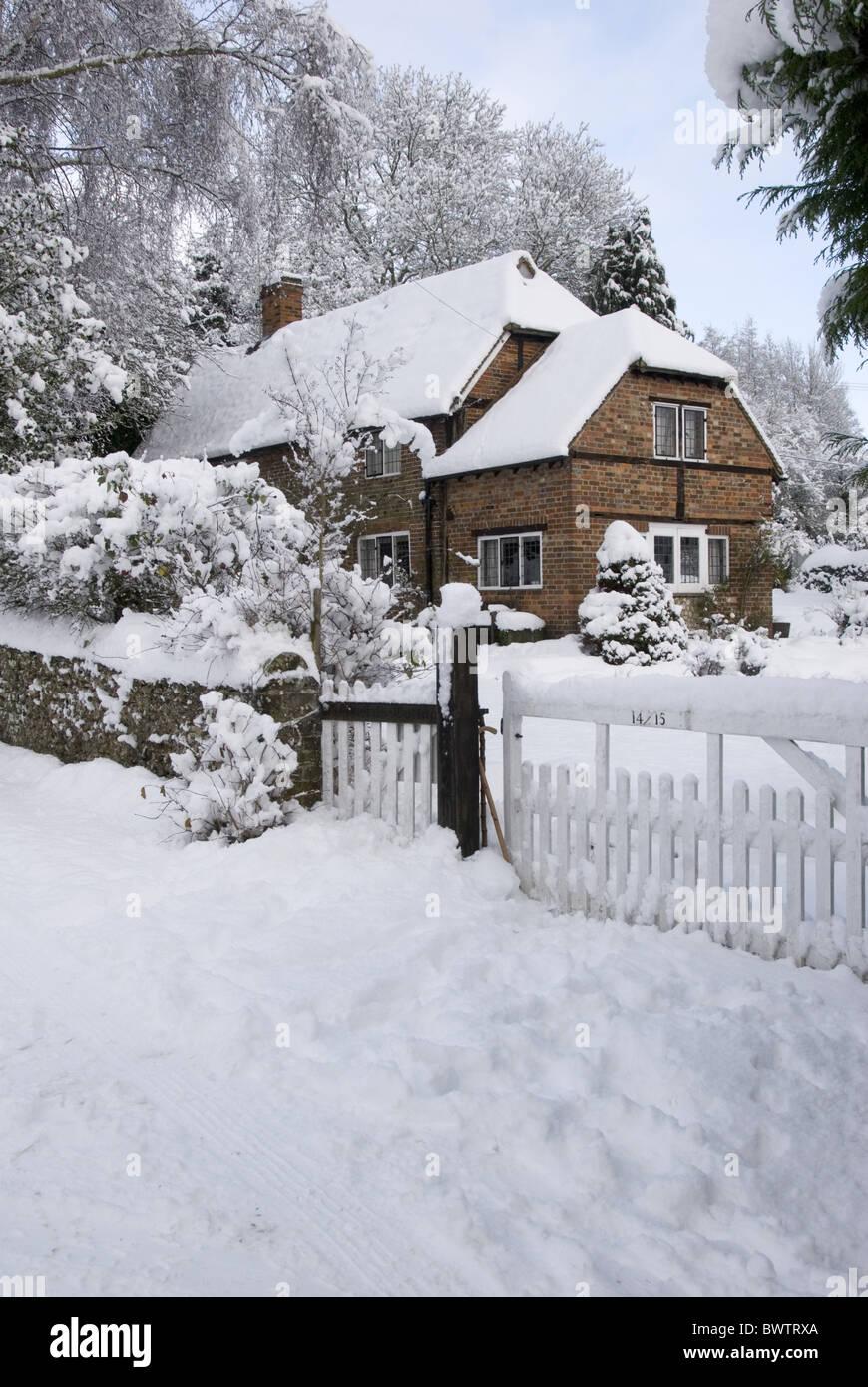 Cottage garden deep snow Chilterns Frithsden - Stock Image