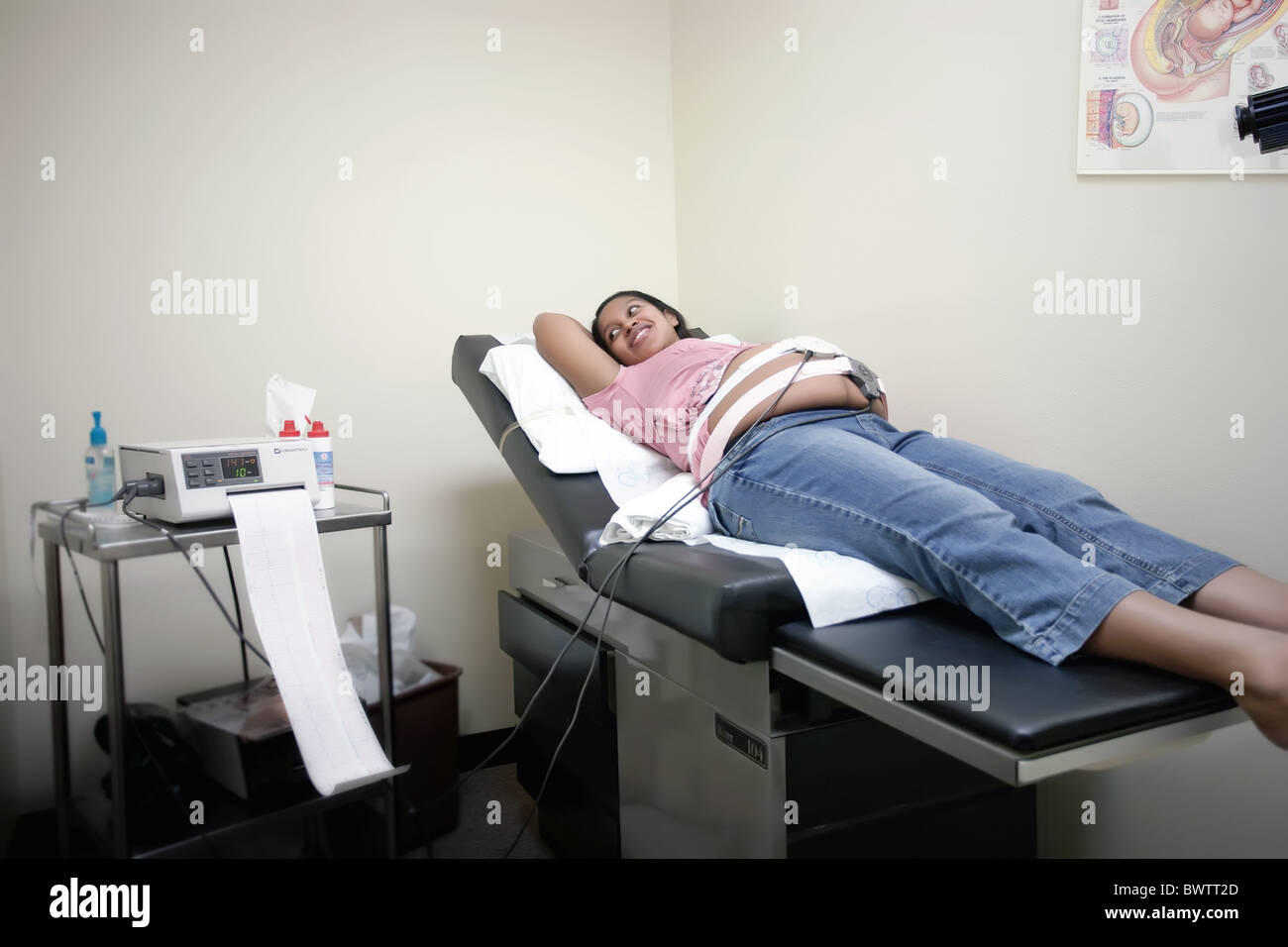 Pregnant mother during a fetal heart monitoring check-up - Stock Image