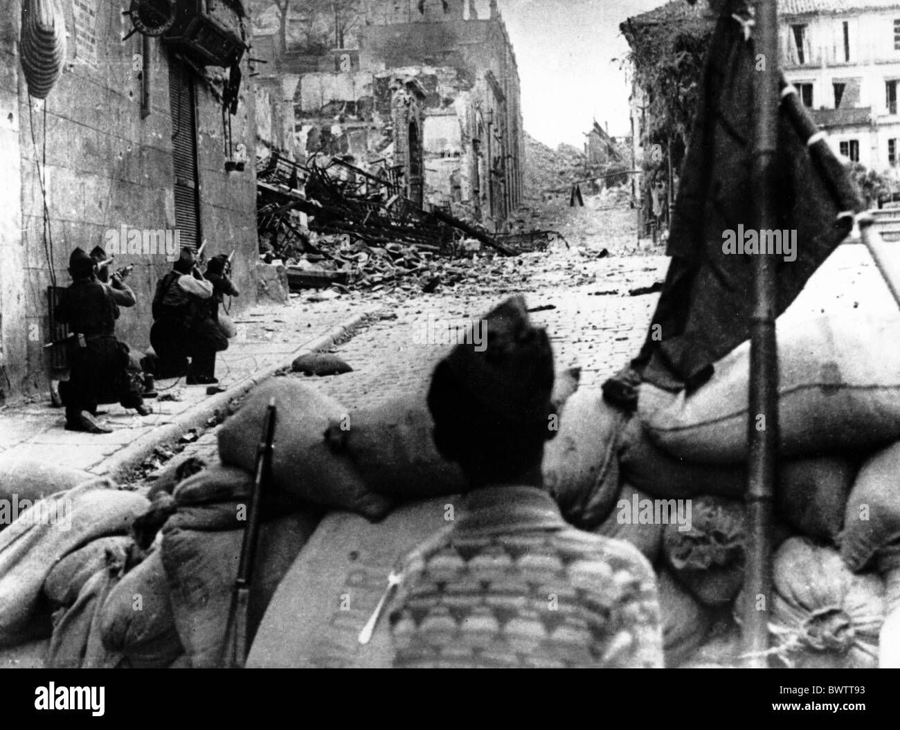 Spanish Civil War Spain Europe Irun Franco troops 1936 sandbag street fighting historical historic history - Stock Image