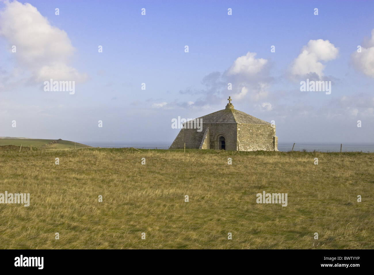 800 years old Ancient Attraction Attractions Blue Sky Britain British Chapel Church Churches Cloud Clouds Coast - Stock Image