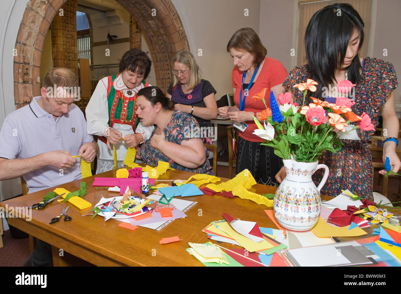 Craft workshop on paper-cuttings and flowers making by folk artist Apolonia Nowak from Kurpie Region of Poland Stock Photo