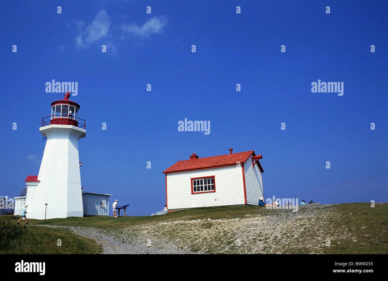 Tourists visiting the lighthouse at Forillon National Park, Gaspé Peninsula, Canada. - Stock Image