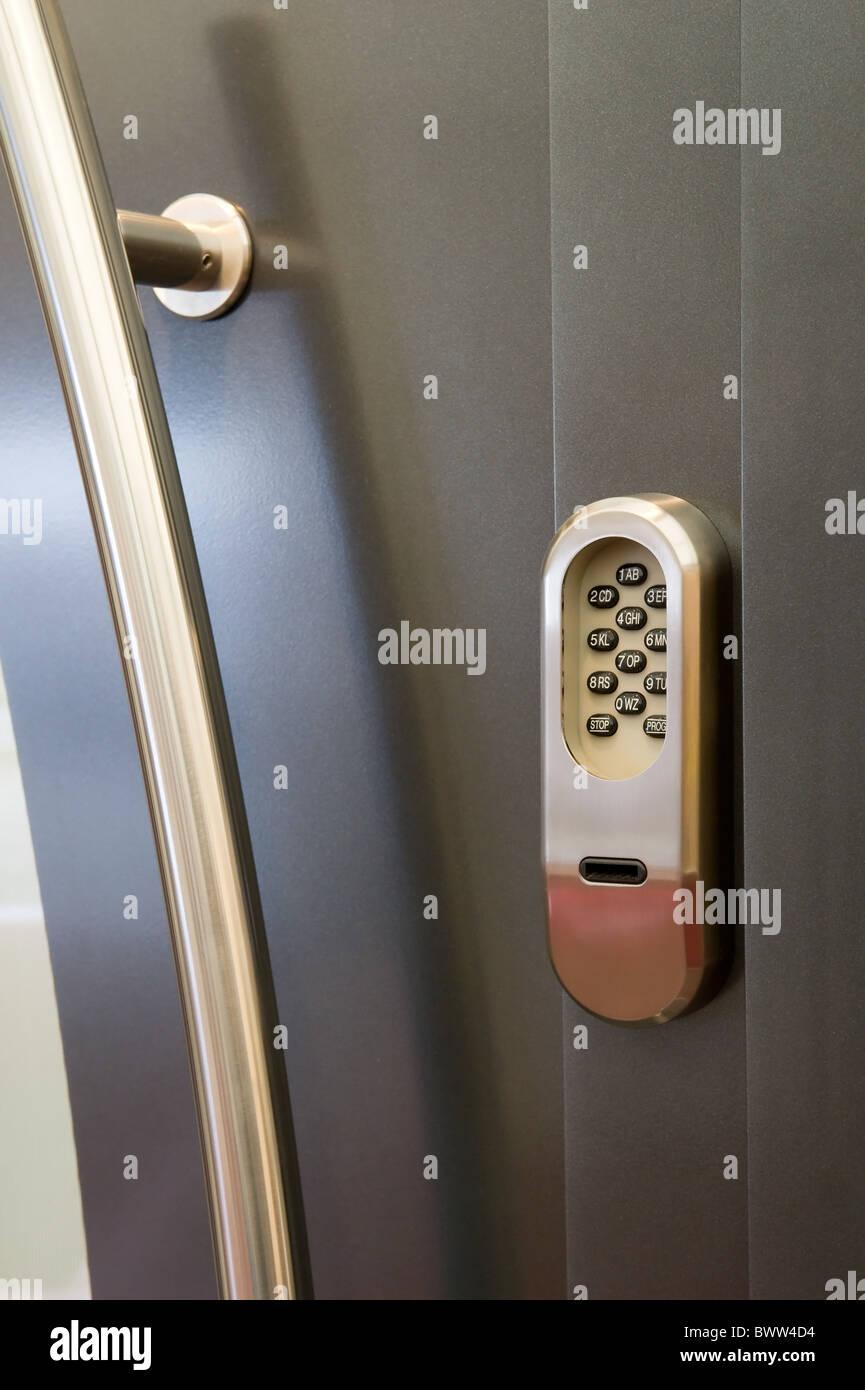 Code lock on a house door Stock Photo