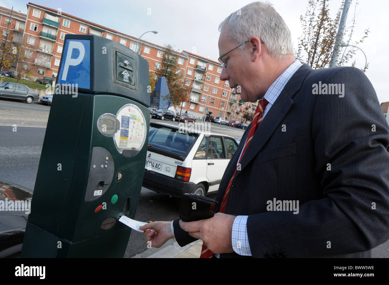 Man buying a parking ticket, Spain - Stock Image