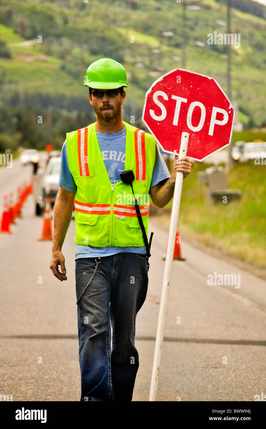 road worker holding stop sign stock photo  33132754