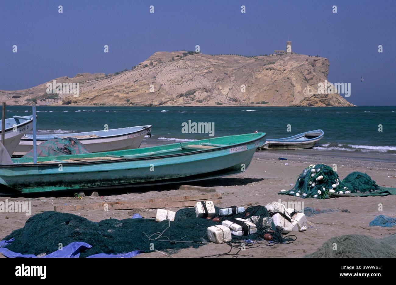 Oman middle East Al-Sawadi Beach fishing boats at Muscat coast beach sea ocean island watch tower nets RegStock Photo
