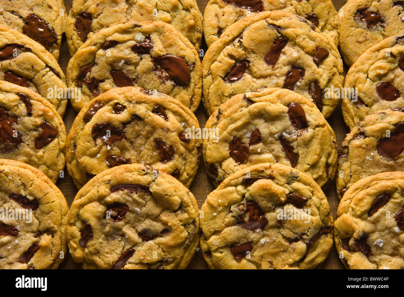 Chocolate Chip Cookies on a Wood Tray over a brown linen napkin. Stock Photo