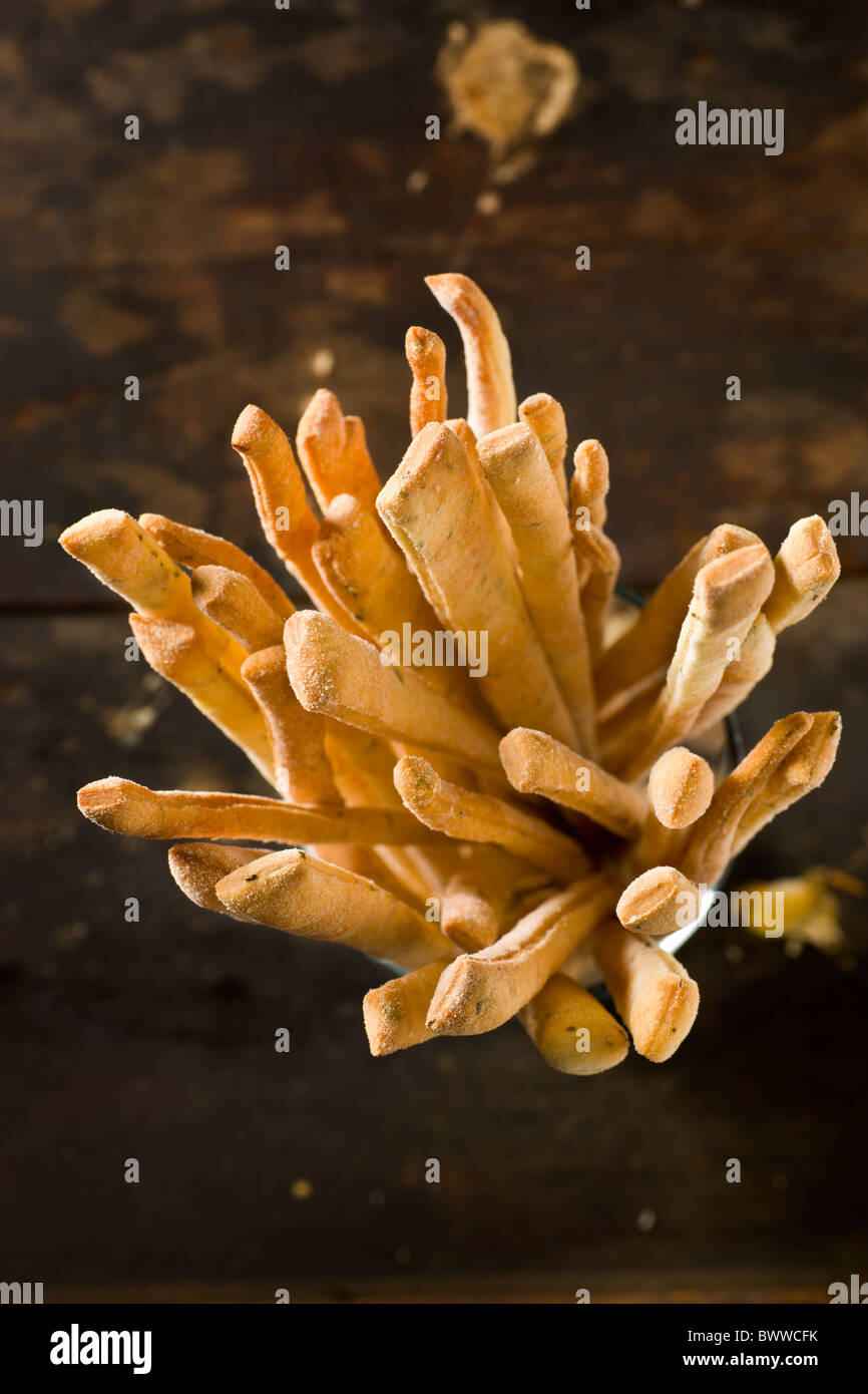 Artisanal Breadsticks on a rustic wood surface Stock Photo