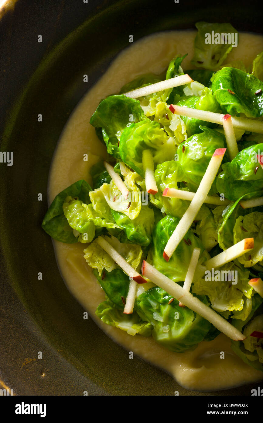 Sautéed Brussel Sprouts leaves with Apple-Mustrad sauce. Stock Photo