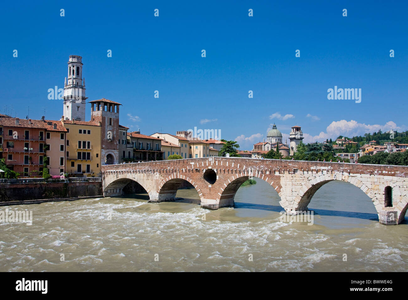 Italy Europe Verona travel Adige river bridge Ponte di Pietra Roman bridge old town city - Stock Image
