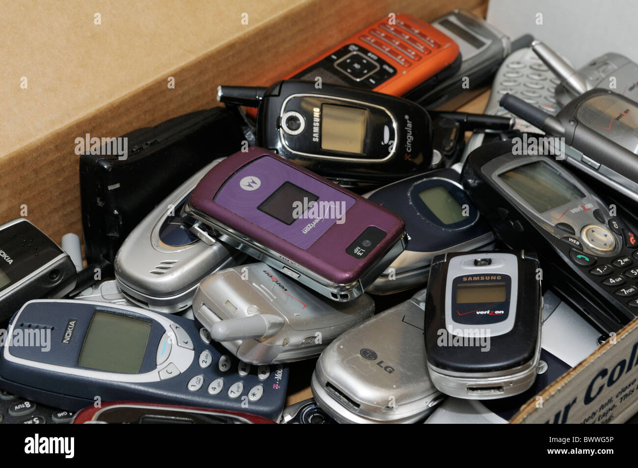 Used cell phones collected to be shipped for recycling - Stock Image