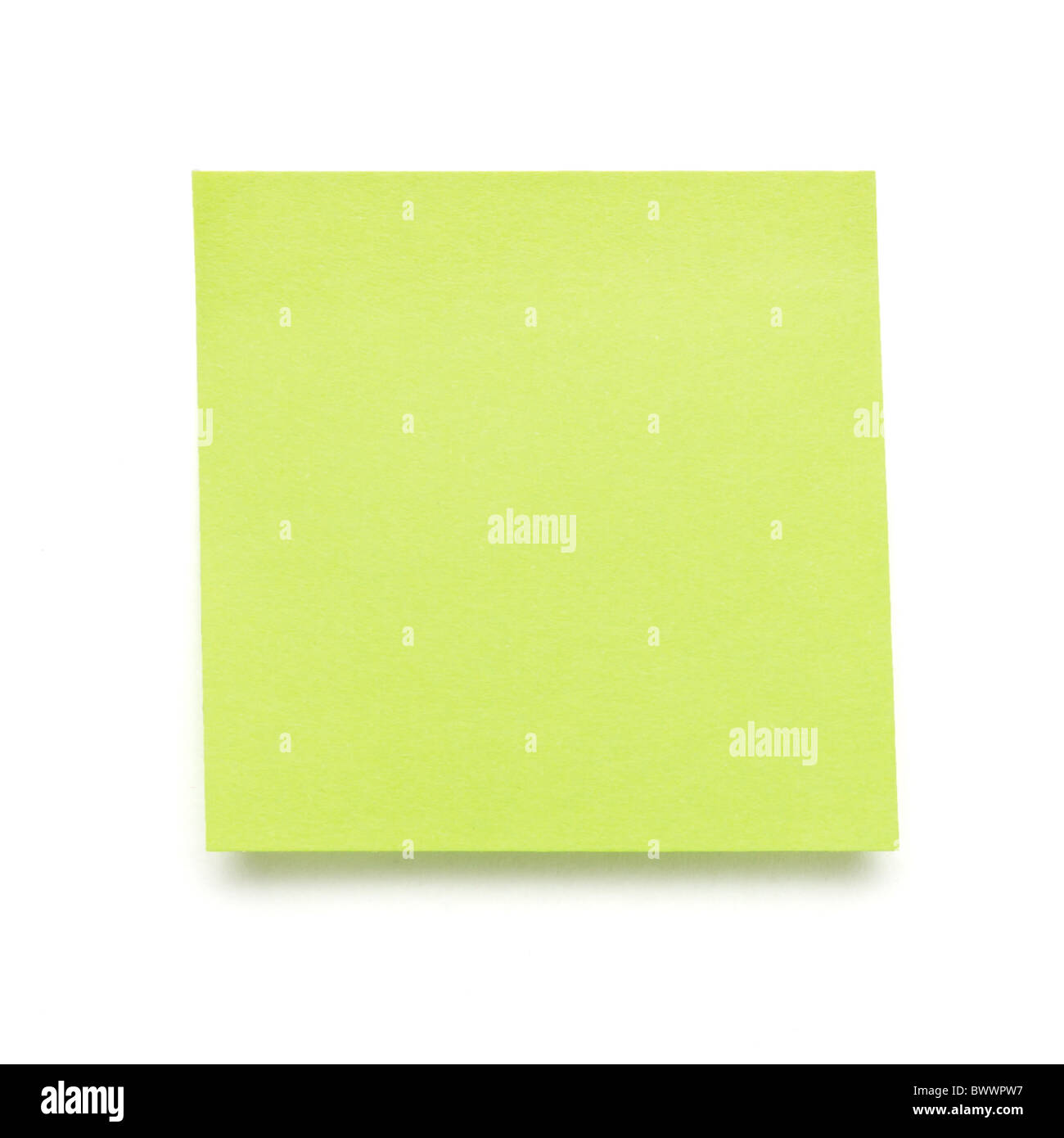 green self adhesive post it note isolated on white. - Stock Image