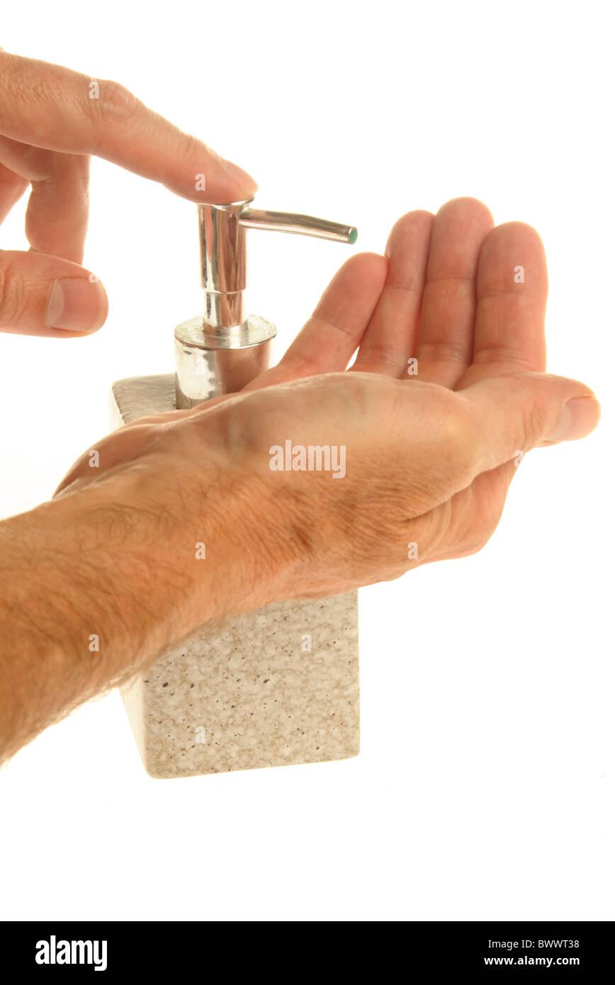 applying hand wash - Stock Image