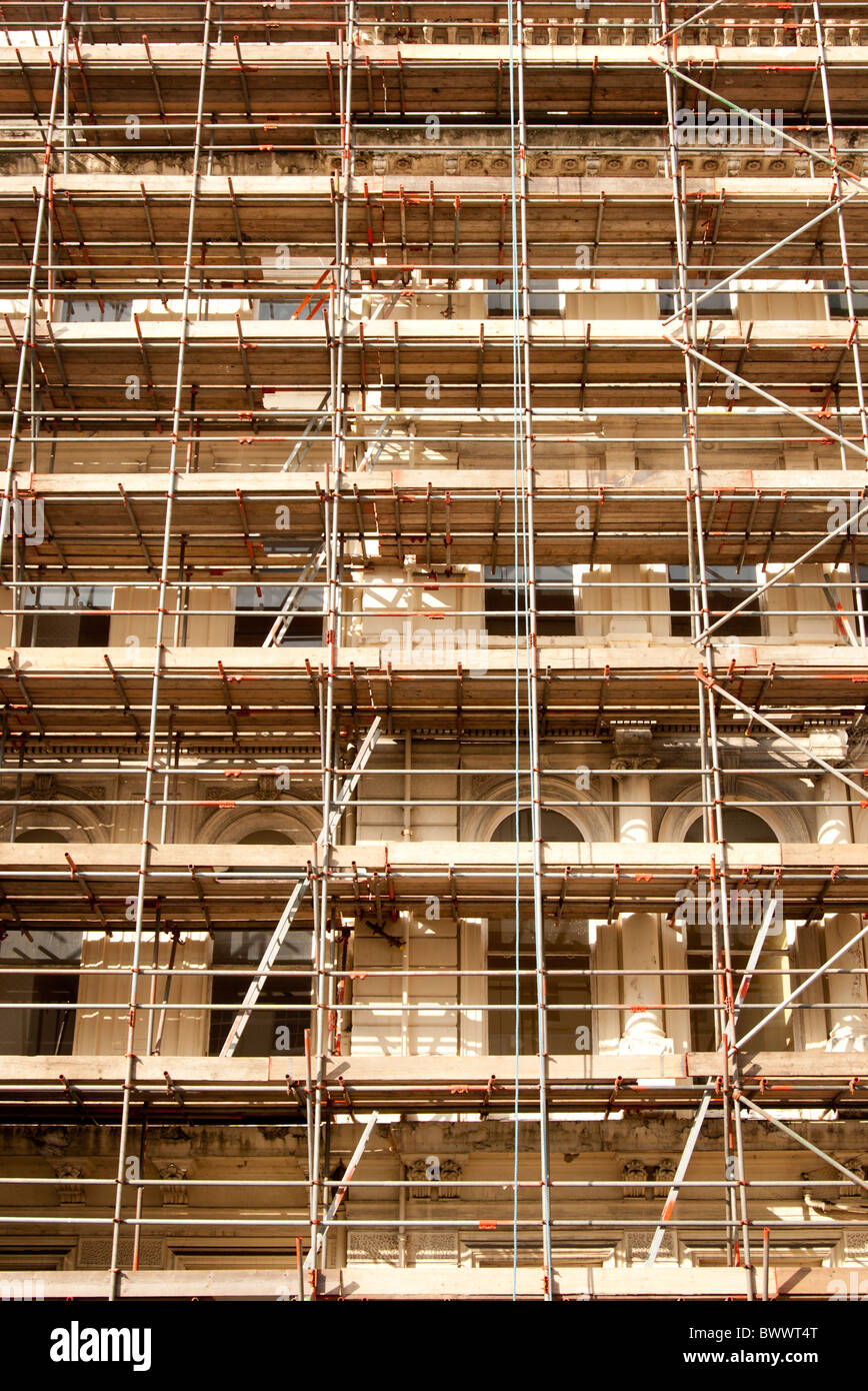 building covered in scaffolding - Stock Image