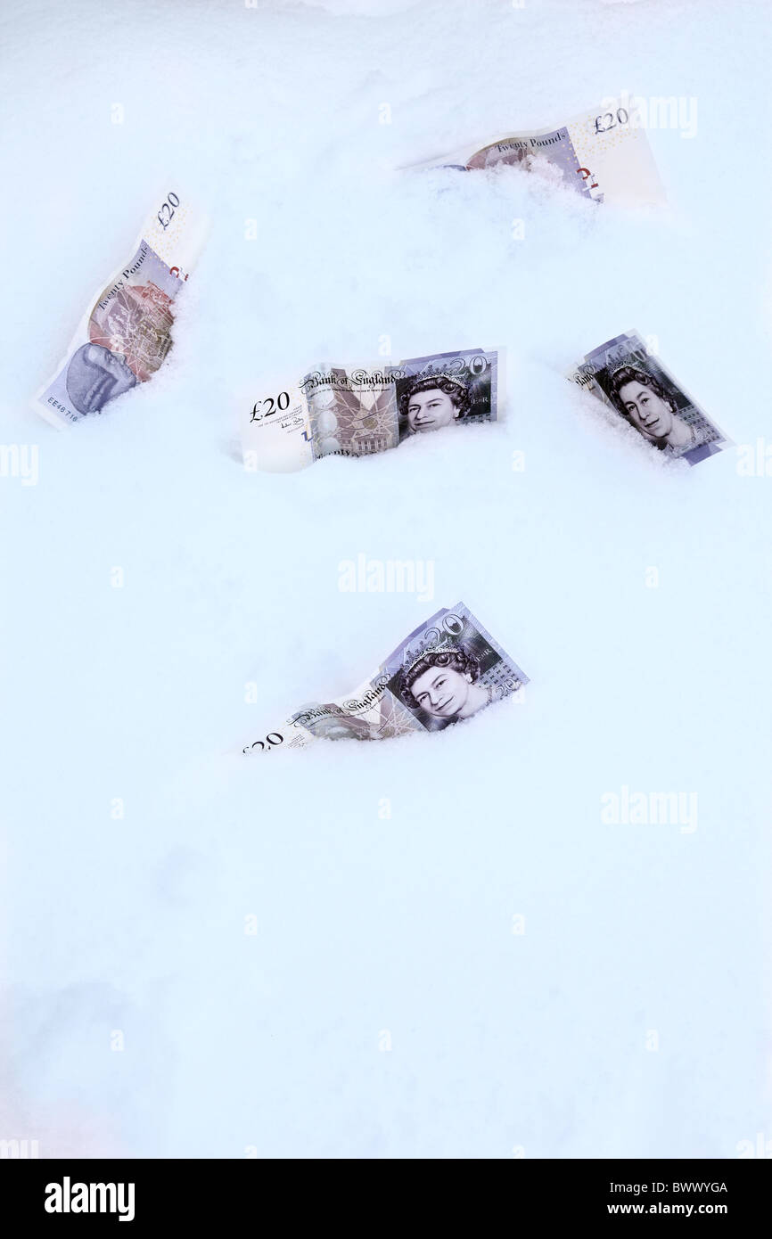 Five £20 notes lying in the snow - Stock Image