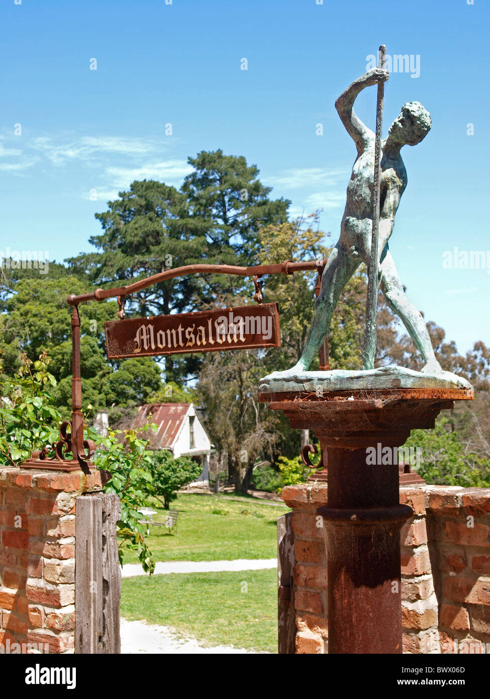 SMALL GATEWAY WITH SIGN AND SCULPTURE  AT MONTSALVAT , ARTIST COMMUNITY  VICTORIA  AUSTRALIA - Stock Image
