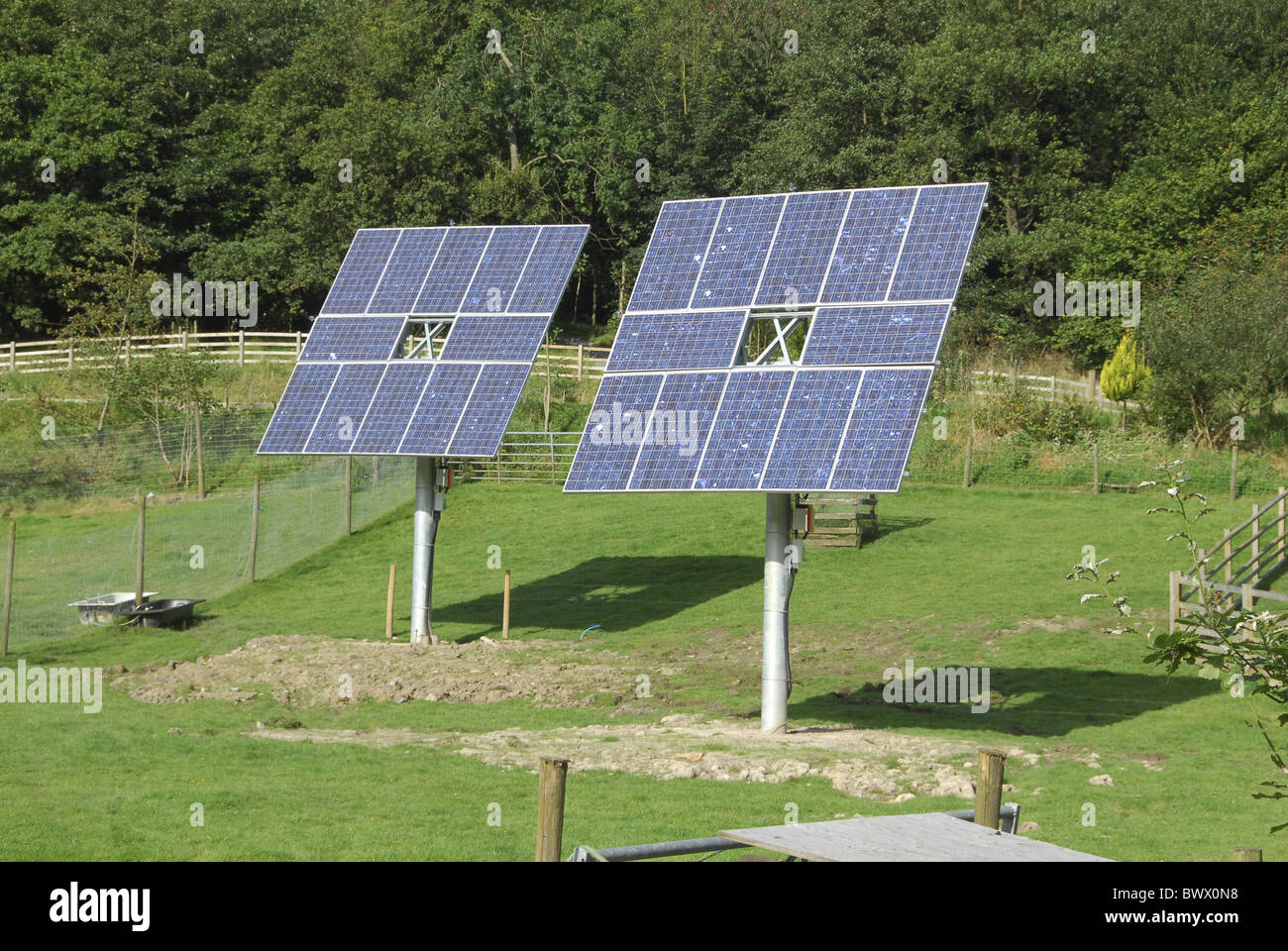 Solar panels used provide electricity hot water - Stock Image