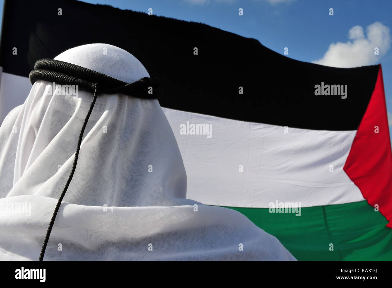 Palestinian people with flag protesting in Israel. - Stock Image