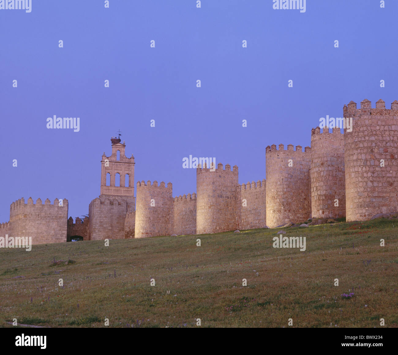 Avila lighting medieval town wall Spain Europe - Stock Image