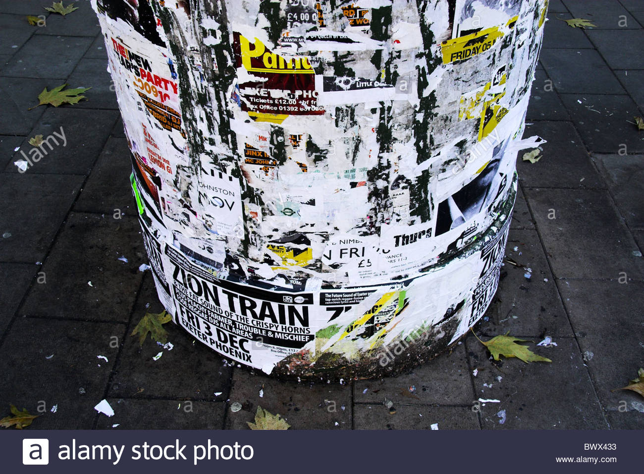 Old bill posters on a round poster column. UK. - Stock Image