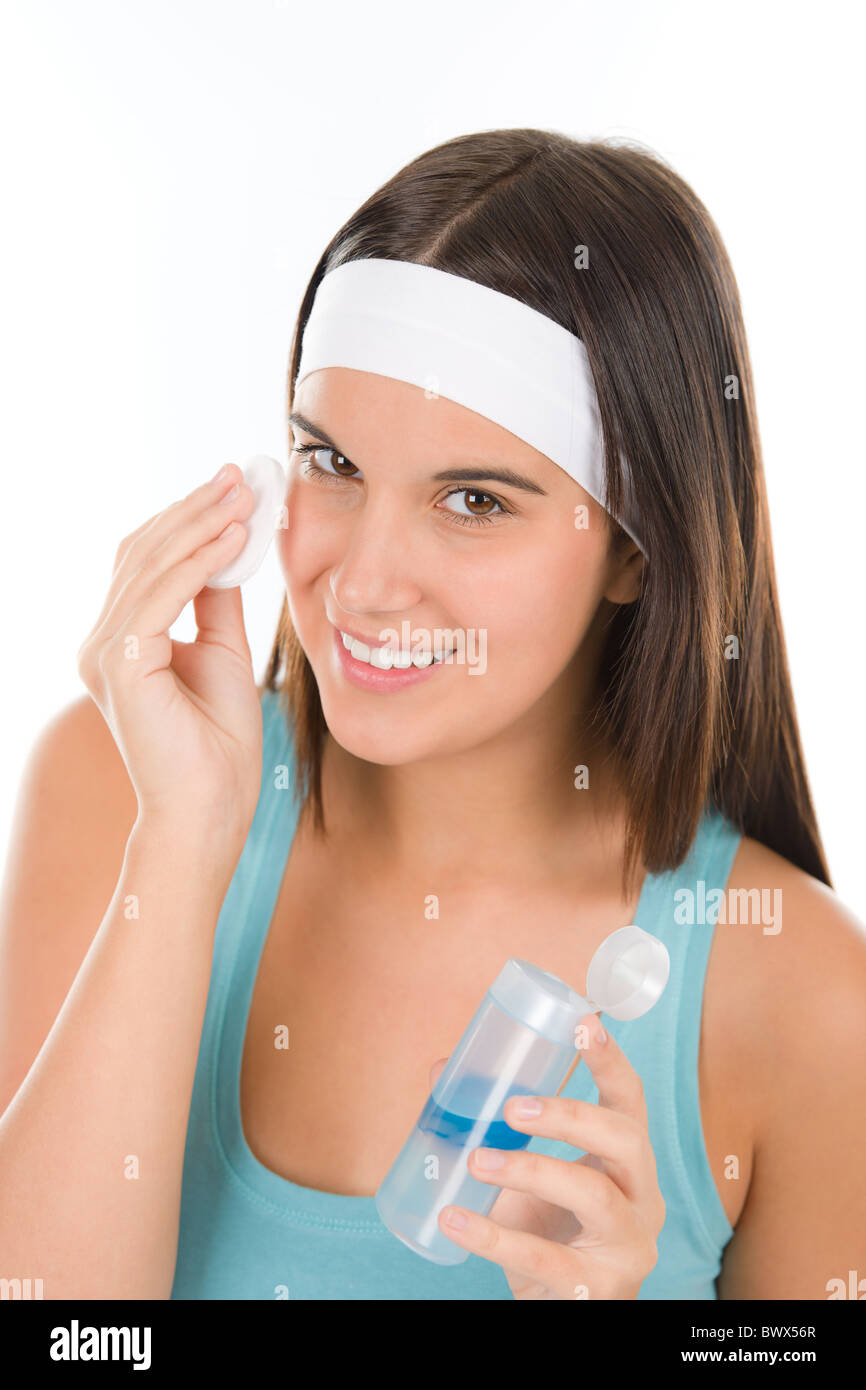 Teenager problem skin care - woman cleanse with cotton pad - Stock Image