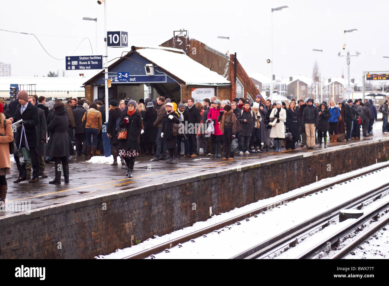 LONDON, UK. Commuters wait at Clapham Junction, the UK's busiest station, for heavily delayed trains to Waterloo. - Stock Image