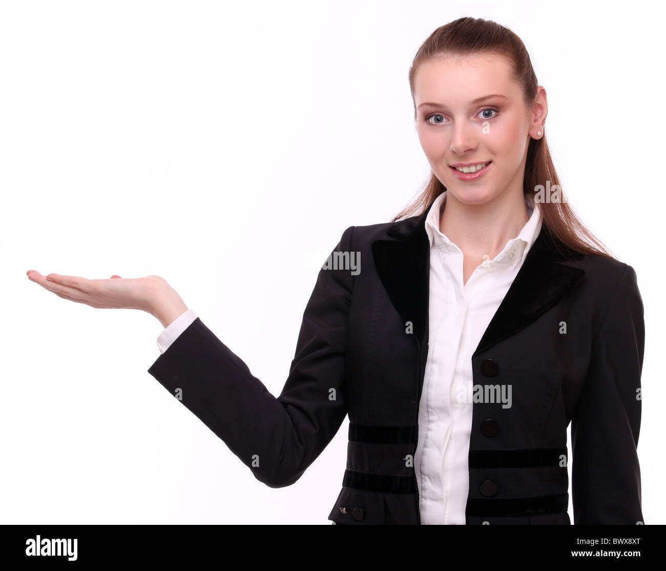 Business woman shows empty hand. Isolated on a white background. - Stock Image