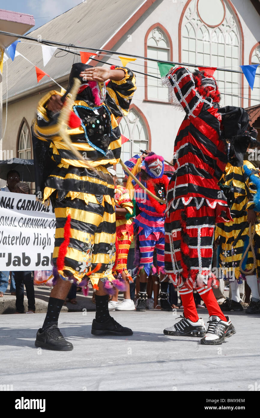 Junior traditional Mas parade - jab jabs whipping each other - Stock Image