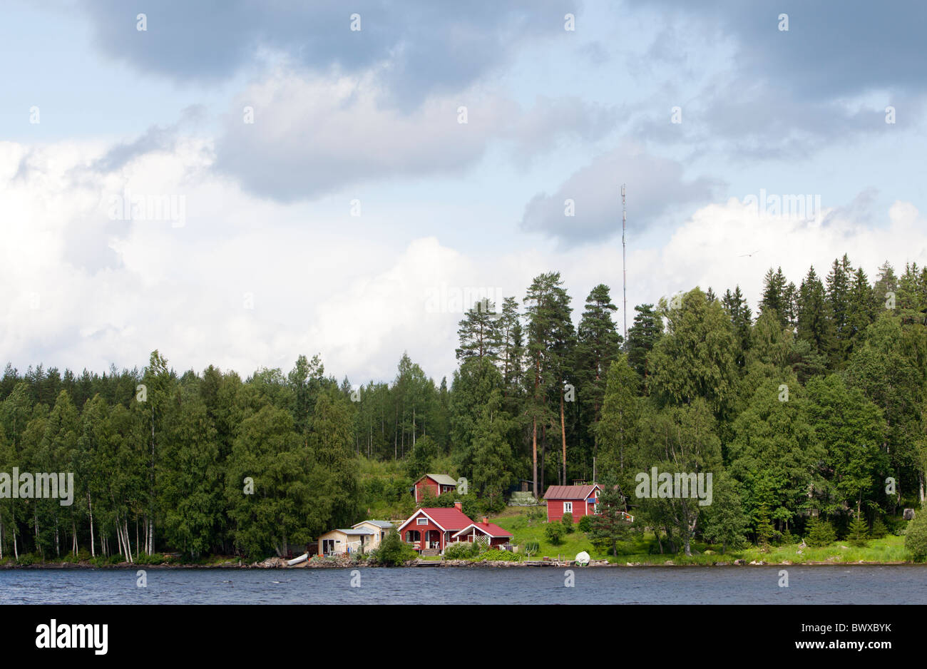 Finnish summer cottage by a lake , Finland - Stock Image