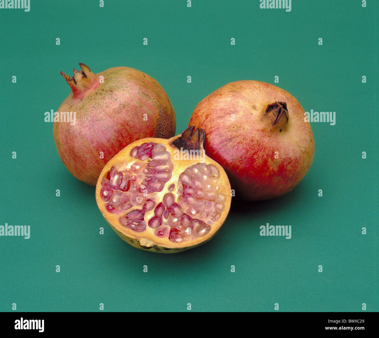 fruits pomegranates three completely cut open cores food eating - Stock Image