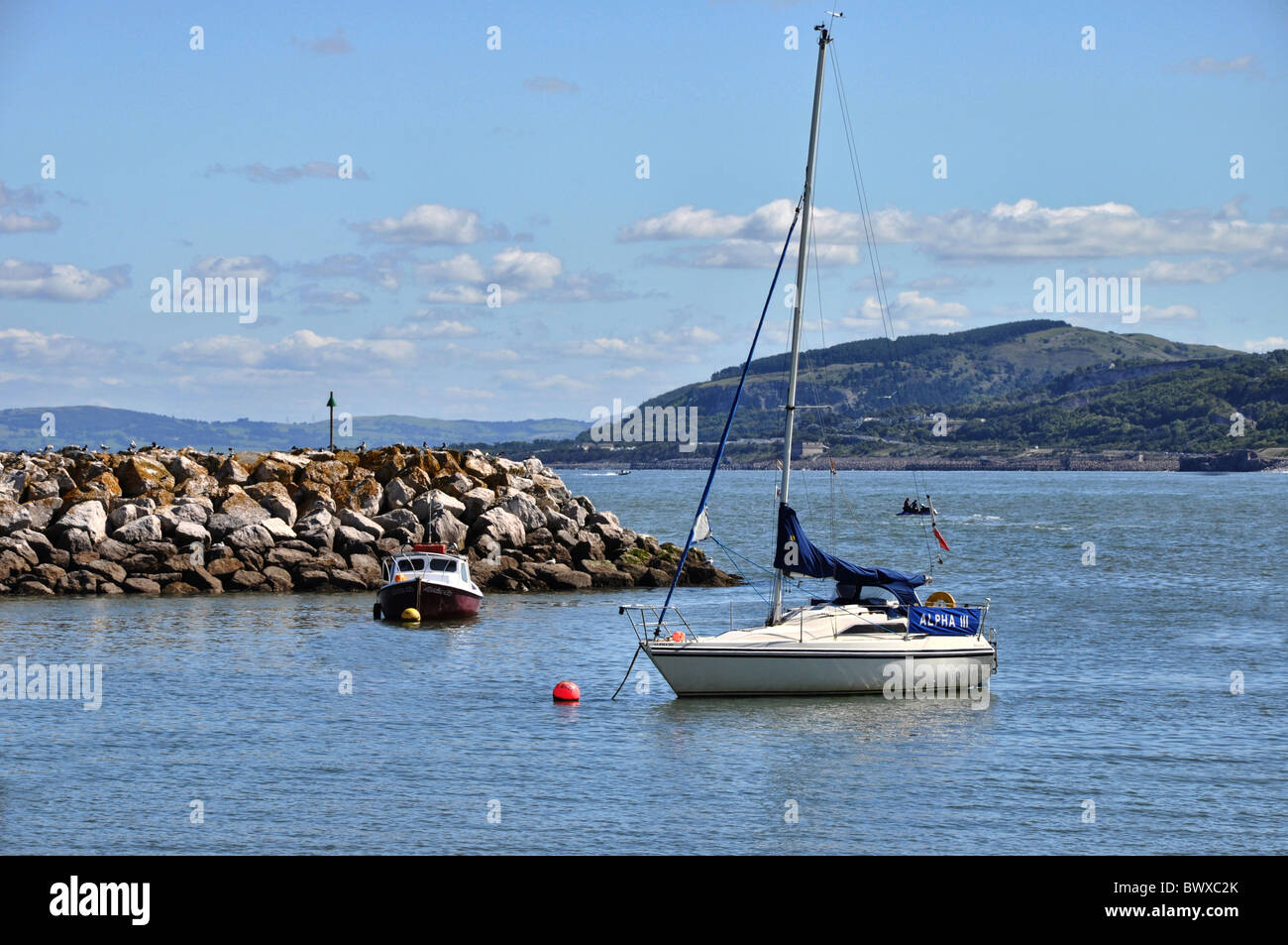 A yacht at anchor in Rhos-on-Sea, North Wales, UK - Stock Image