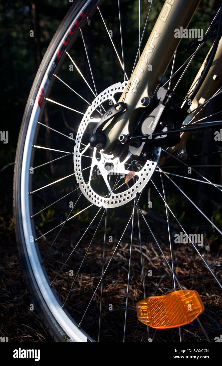 Shimano hydraulic disc brakes in bicycle front wheel - Stock Image