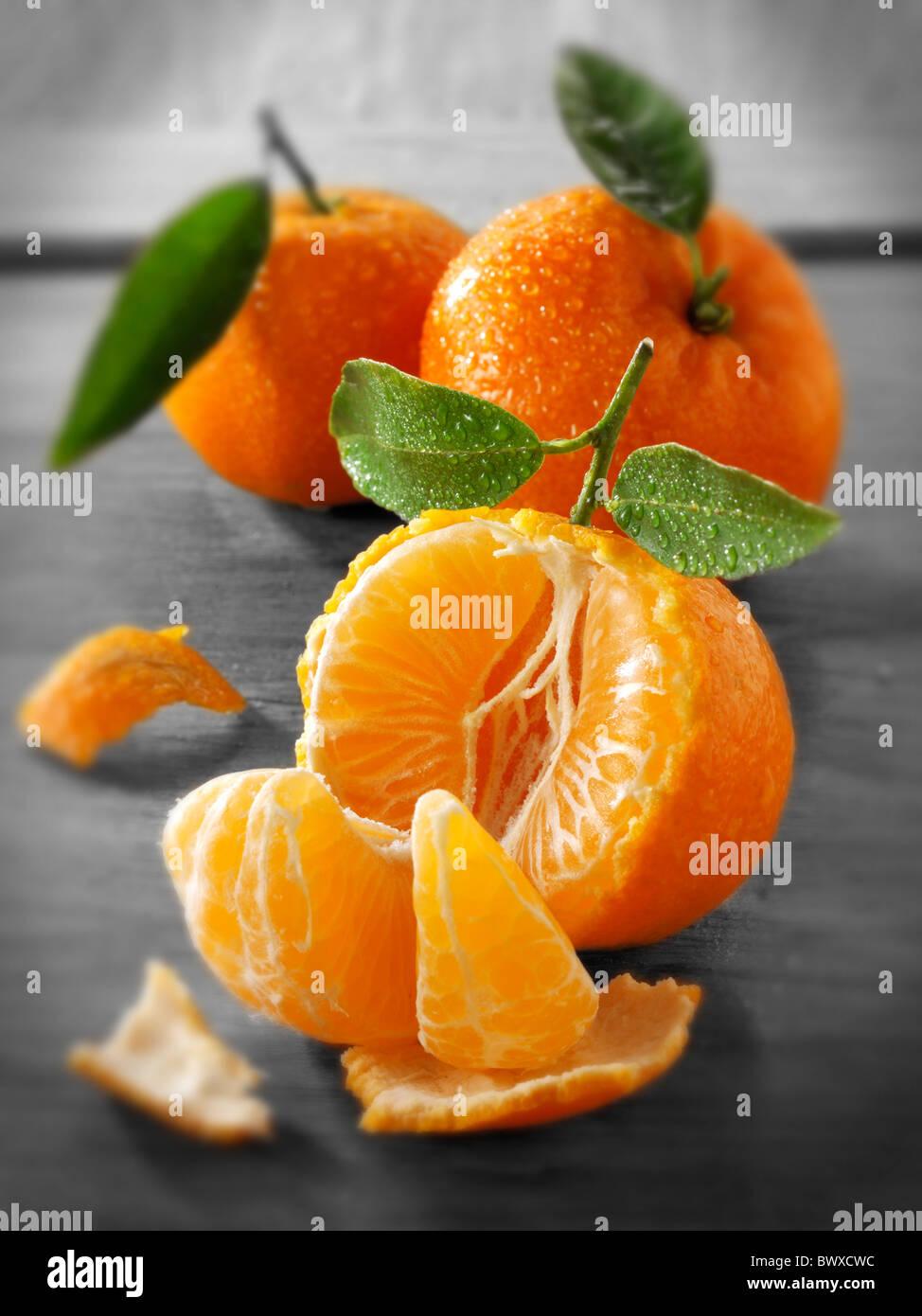 Fresh mandarins fruits with leaves. - Stock Image